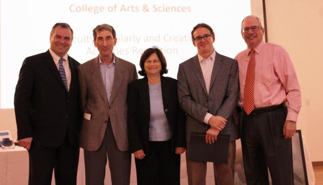 Dean of the College of Arts and Sciences Leonidas Bachas and Provost Thomas J. LeBlanc stand with Cooper Fellows Professor Michael Miller, Professor Gail Ironson, and Professor Francisco Raymo.