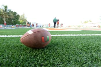 "football on the field with ""U"" logo"